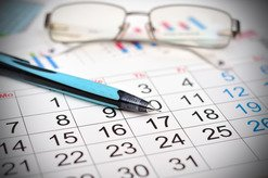 Glasses and Pen on Calendar
